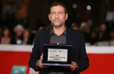 ROME, ITALY - OCTOBER 26: Alessandro Piva poses on the red carpet with the BNL People's Choice Award during the 14th Rome Film Festival on October 26, 2019 in Rome, Italy. (Photo by Ernesto S. Ruscio/Getty Images for RFF)